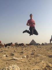 Happy Kevin jumping over a pyramid